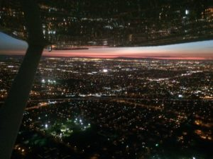 flying over Los Angeles at dusk